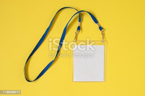 istock Empty ID card badge icon with blue belt on yellow background 1138469272