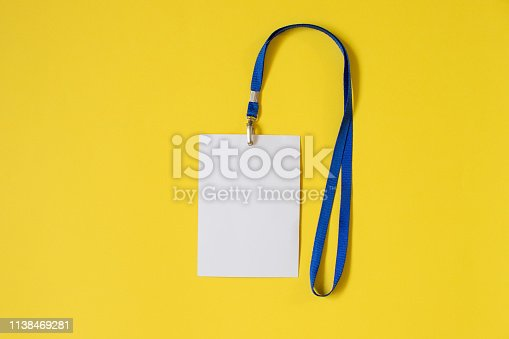 istock Empty ID card badge icon with blue belt on yellow background 1138469281