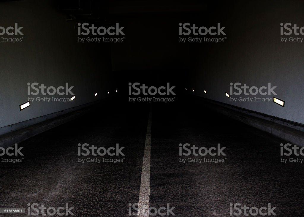 Empty illuminated tunnel in Berlin stock photo