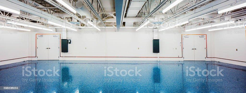 Empty Industrial Storeroom panorama with neon lighting stock photo