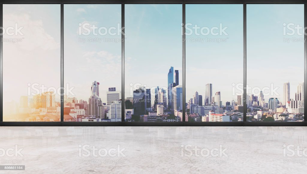 Empty interior space, concrete floor with glass wall and modern buildings in the city view stock photo
