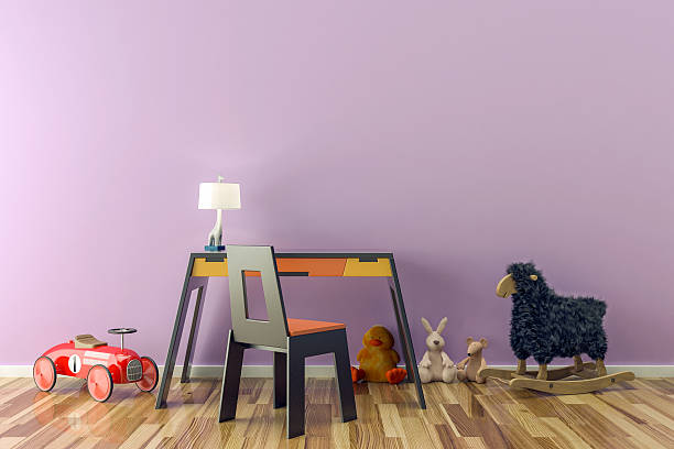 Empty kids room with toys, work desk and chair. stock photo