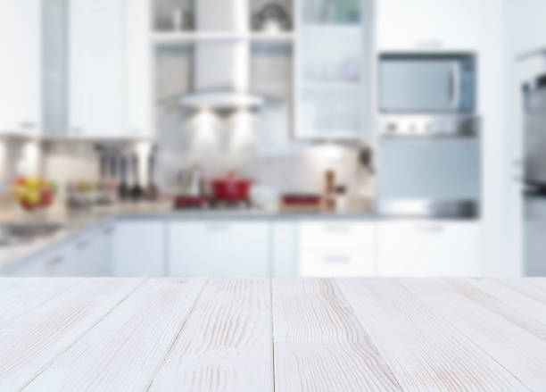 Empty kitchen countertop Empty kitchen countertop with defocused modern kitchen background. Highly suitable for product montage kitchen counter stock pictures, royalty-free photos & images