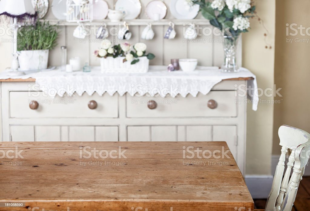 Empty kitchen table in cottage style home stock photo