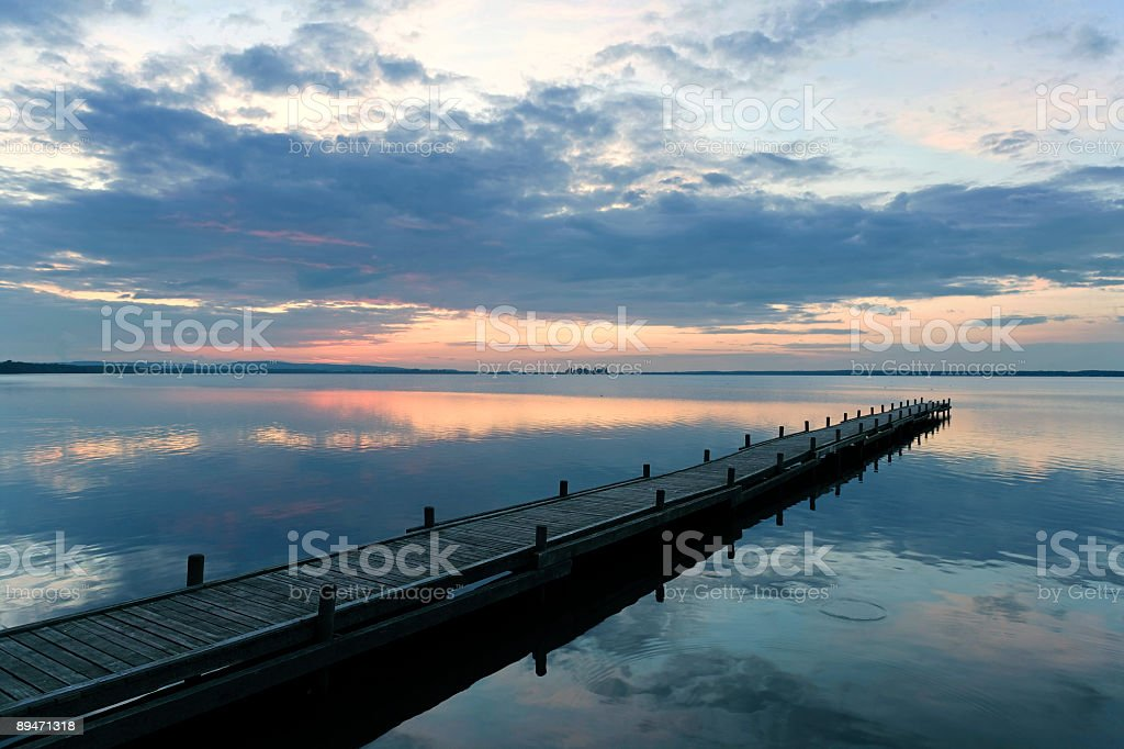 Empty lakeside jetty with majestic cloudscape at sunset (XXL) royalty-free stock photo