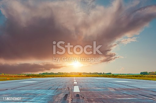 864534880 istock photo Empty lane in the morning at dawn at the airport. 1180243407