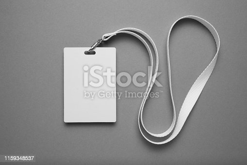 istock Empty layout layout. Common blank label name tag hanging on neck with thread 1159348537