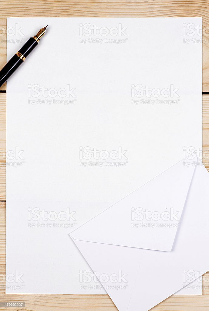empty letter an envelope and pen on wooden background stock photo