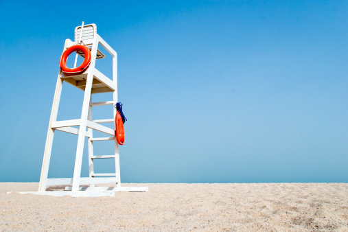 Empty Lifeguard Chair On The Beach Stock Photo - Download Image Now