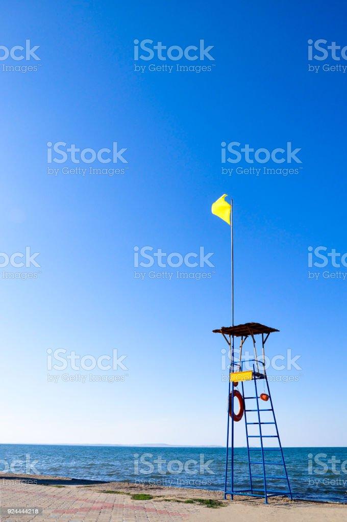 Empty lifeguard tower on the beach stock photo