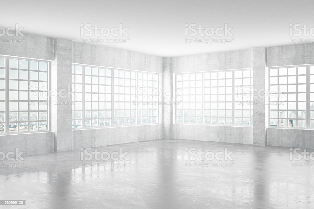 Empty light concrete room with windows and city view stock photo