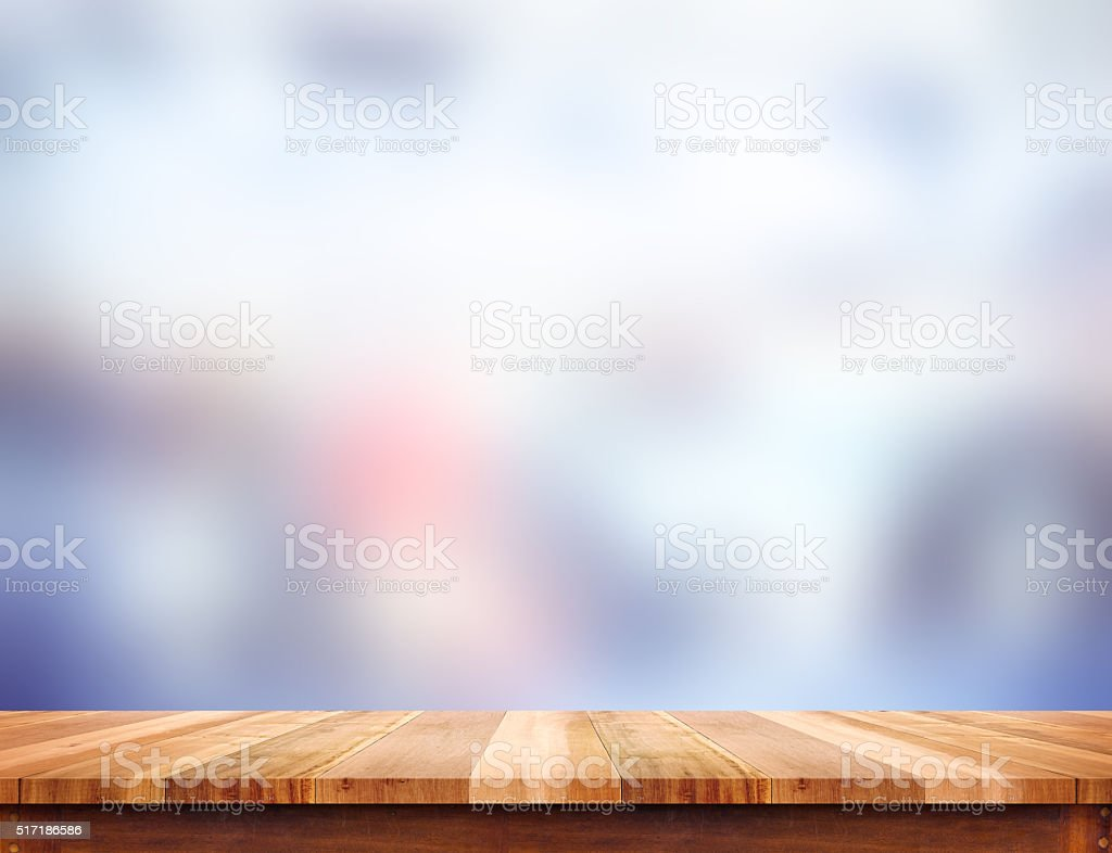 Empty light wood table top with blur abstract background, stock photo