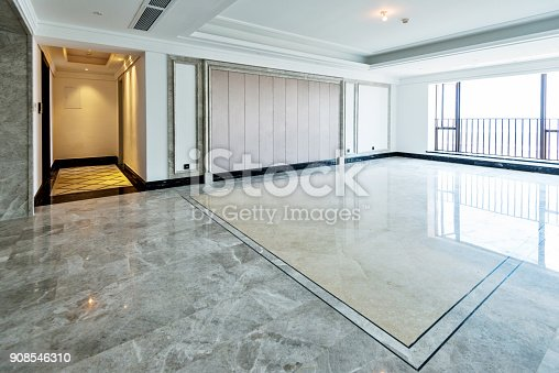 istock Empty living room in modern apartment 908546310