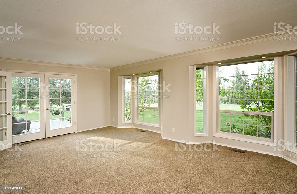 Empty living room with bay windows stock photo