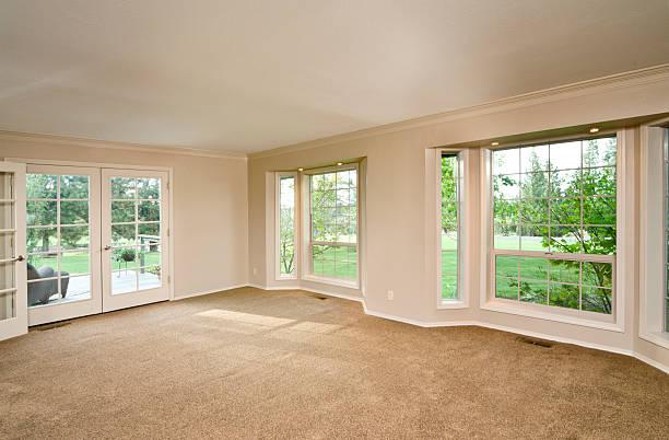 Empty living room with bay windows stock photo