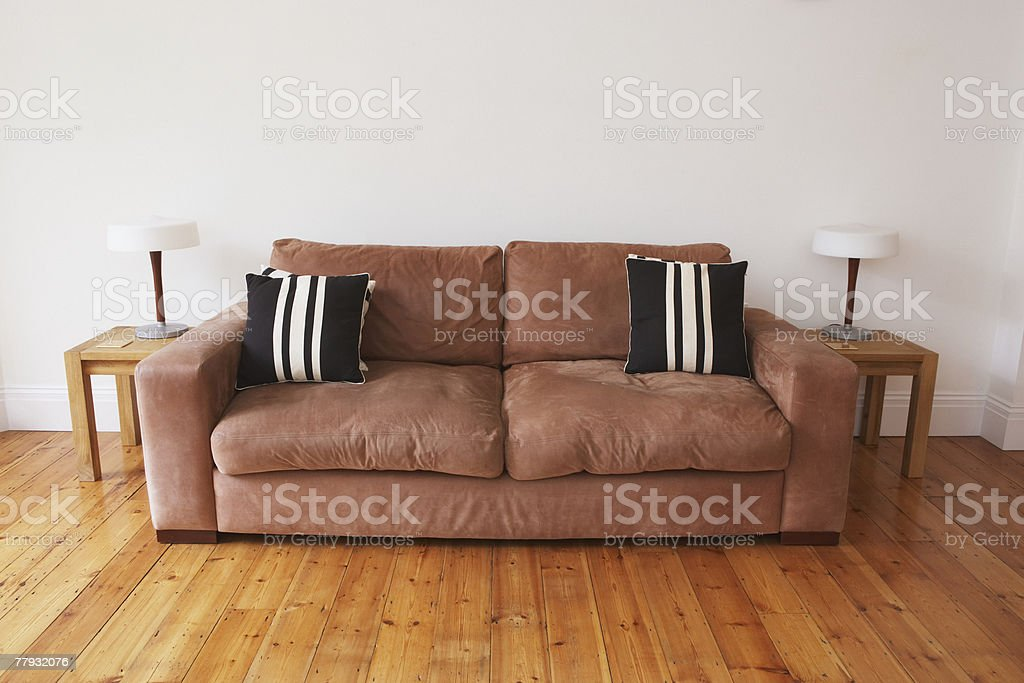 Empty living room with couch and end tables stock photo