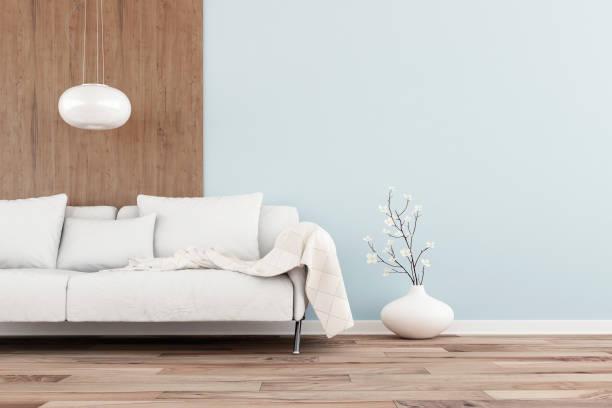 leeres wohnzimmer mit sofa - hellblaues zimmer stock-fotos und bilder