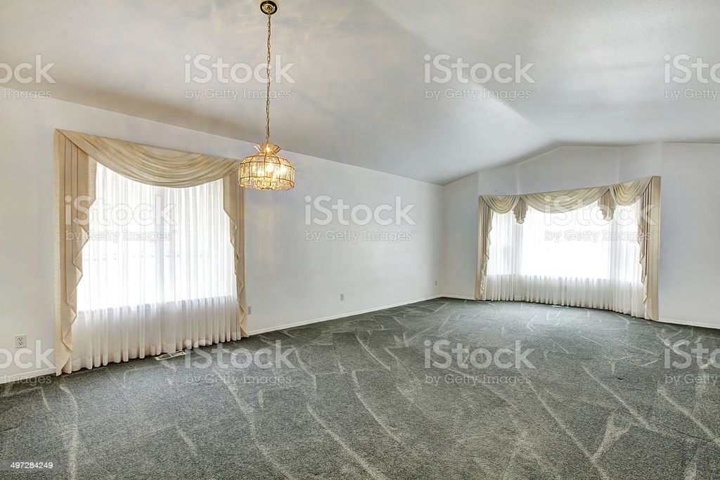 Empty Living Room With Vaulted Ceiling And Green Carpet Floor Stock Photo Download Image Now Istock