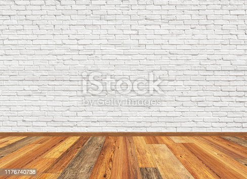Empty living room with wooden parquet floor and old white painted brick wall. 3D rendering illustration for design interior.