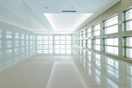 Empty lobby with glass window in hospital.