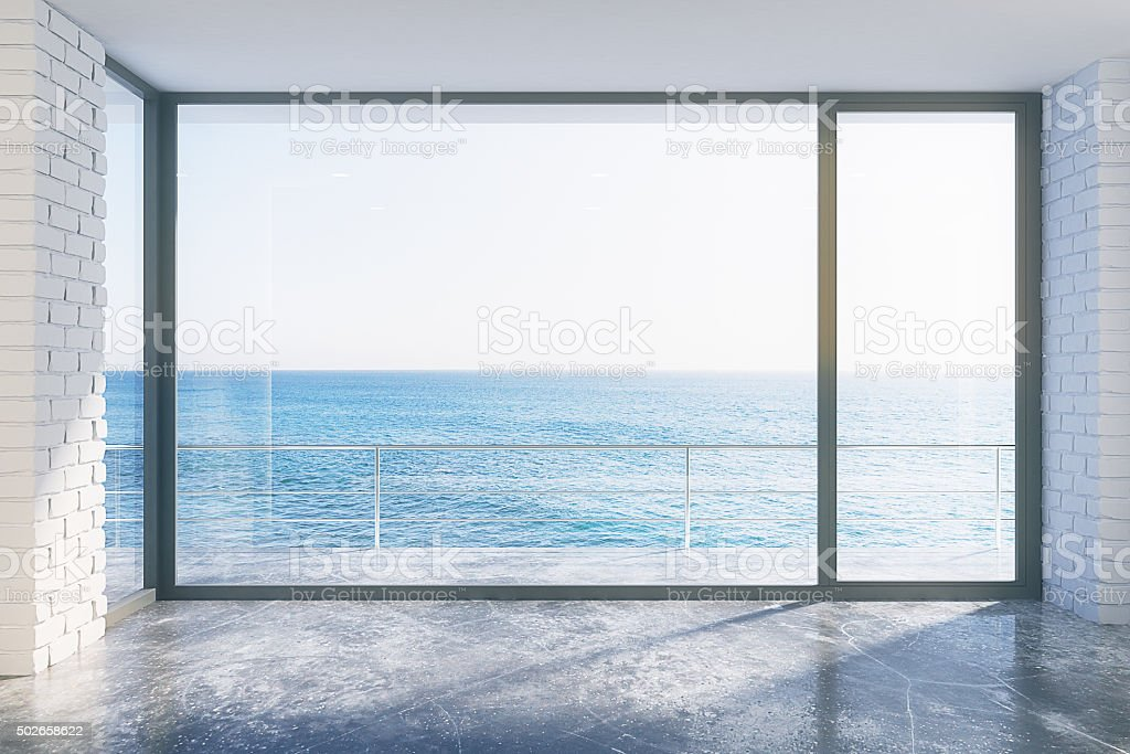 Empty loft style with concrete floor and ocean view