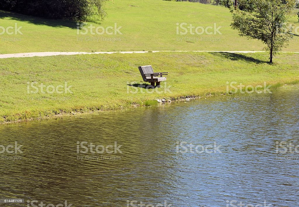Empty, Lonely Bench at the Park stock photo