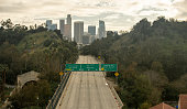 A Los Angeles freeway that usually has bumper-to-bumper traffic eerily sits empty as people are staying home during the Covid-19 pandemic of 2020.