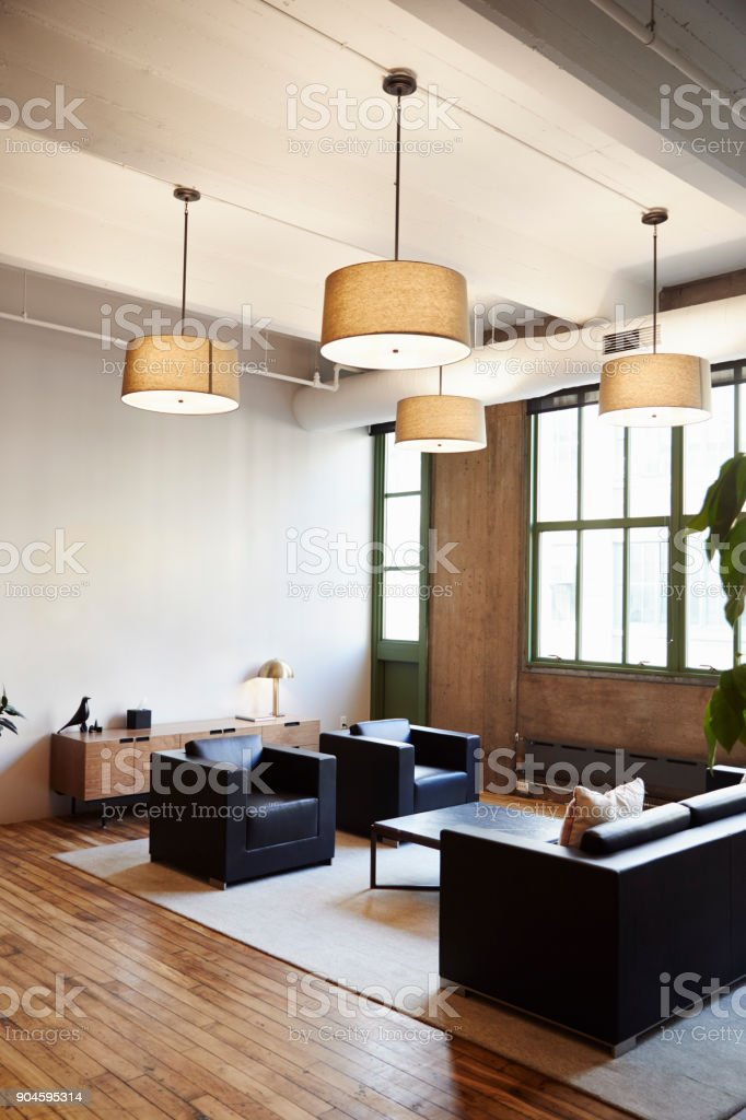 Empty lounge area in luxury business premises, vertical stock photo
