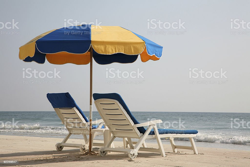Empty lounge chairs on the beach royalty-free stock photo