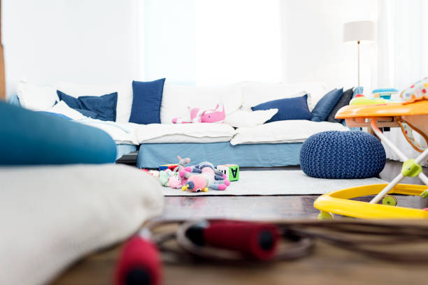 Empty lounge room with scattered toys stock photo