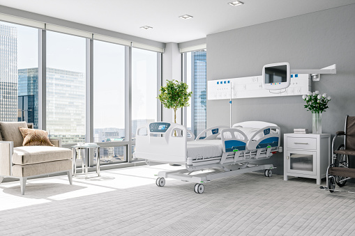 Interior of a modern luxury hospital room with city view.