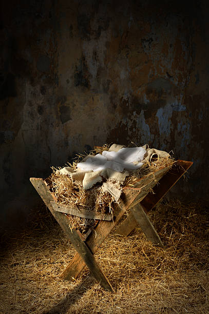 Empty Manger With Cross Shadow stock photo