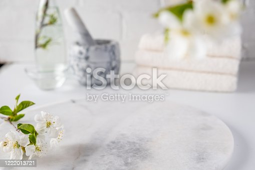 istock Empty marble board for product display with blurred bathroom interior background. Spa and bodycare 1222013721