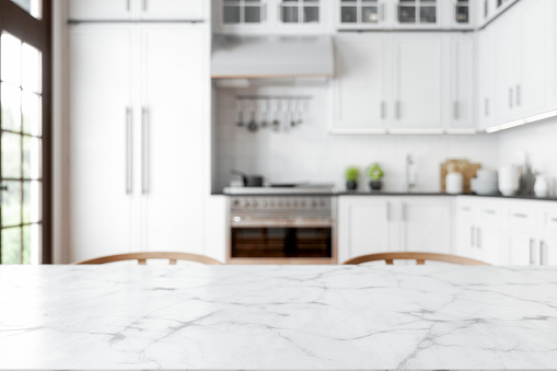 Empty Marble Dining Table With Wooden Chairs And Defocused Kitchen Background.