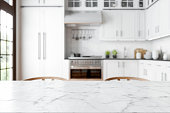 istock Empty Marble Dining Table With Wooden Chairs And Defocused Kitchen Background. 1286266294