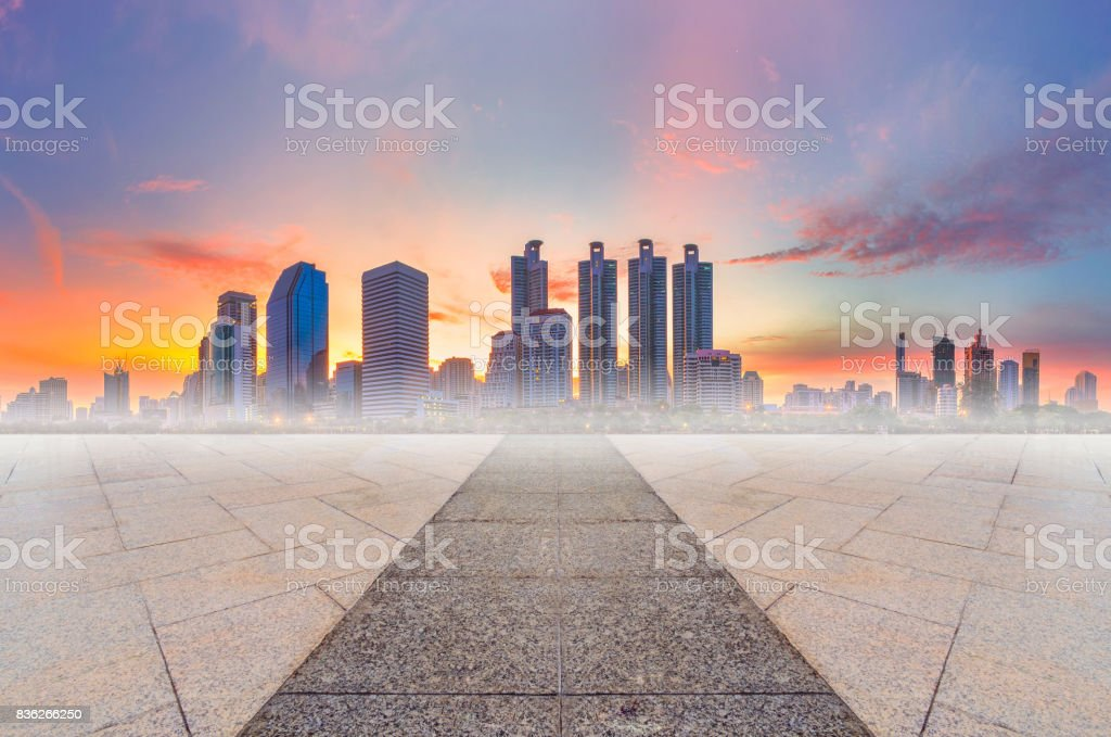 Empty marble floor with modern building in the city skyline colorful sky at the morning. stock photo