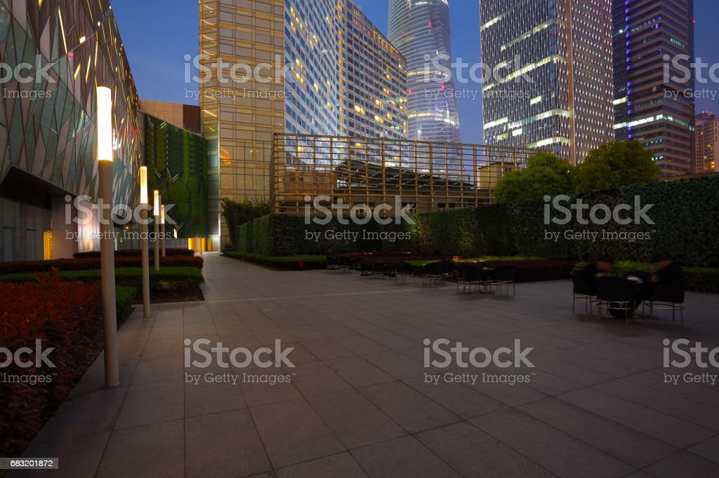 Empty marble road floor surface with modern city buildings of night scene in Shanghai 免版稅 stock photo