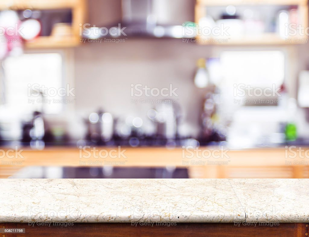 Empty marble table top and blurred kitchen bokeh light stock photo