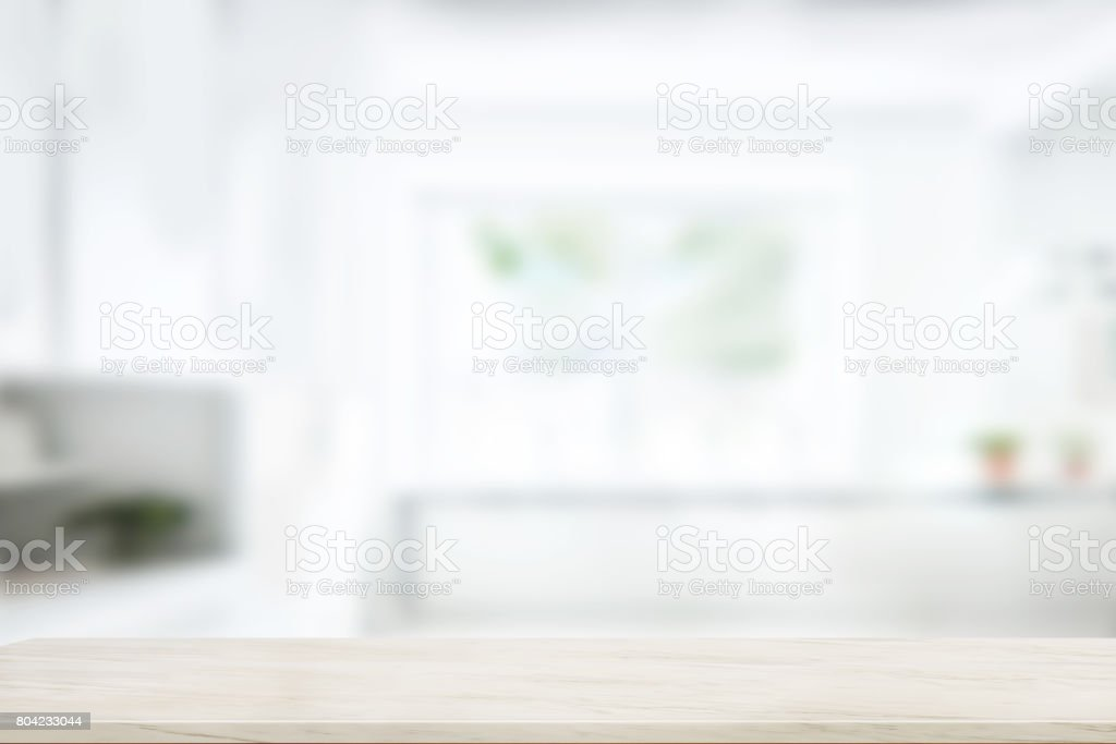 Empty marble table top in blurred modern kitchen room background.