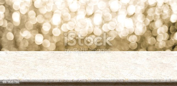 istock Empty marble table top with sparkling gold bokeh abstract background,panoramic banner for display or montage of product,Holiday seasonal concept backdrop 697805750