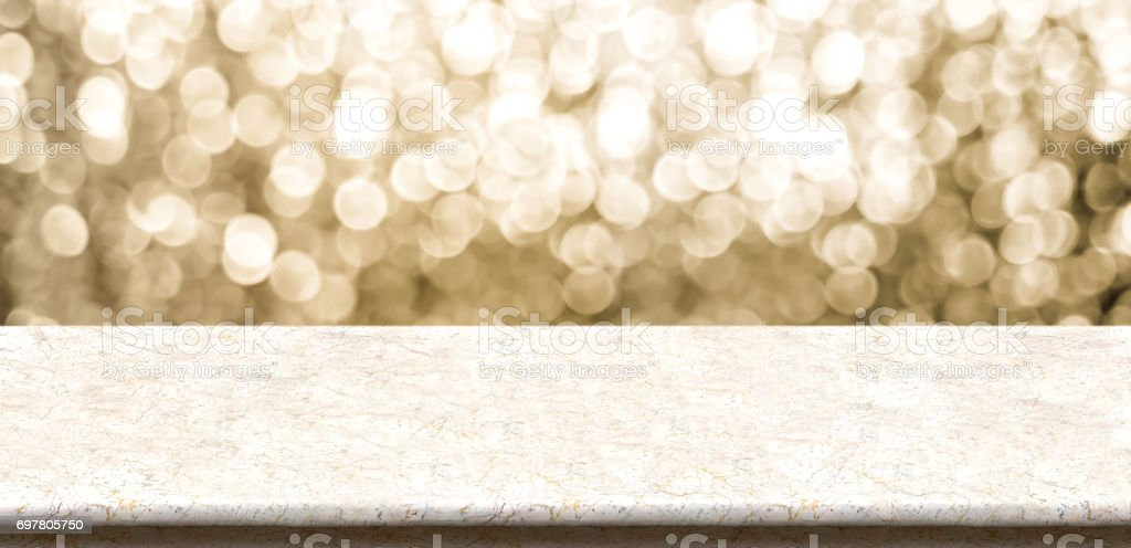 Empty marble table top with sparkling gold bokeh abstract background,panoramic banner for display or montage of product,Holiday seasonal concept backdrop stock photo