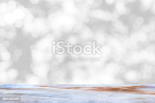 istock Empty marble table with backdrop blurred nature background, Can be used for display your product 894493490
