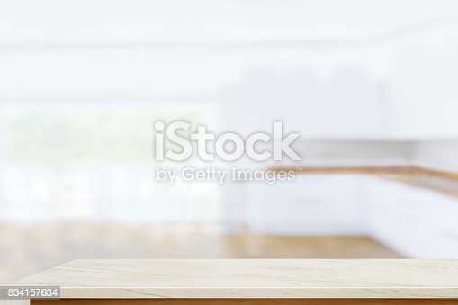 834157738istockphoto Empty marble table with blurred modern kitchen room background. 834157634