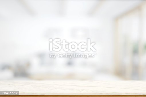 834157738istockphoto Empty marble table with blurred modern kitchen room background. 834157738