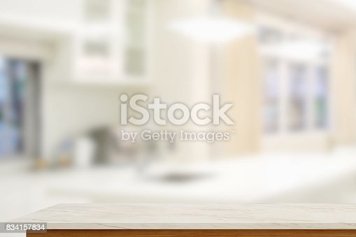 834157738istockphoto Empty marble table with blurred modern kitchen room background. 834157834