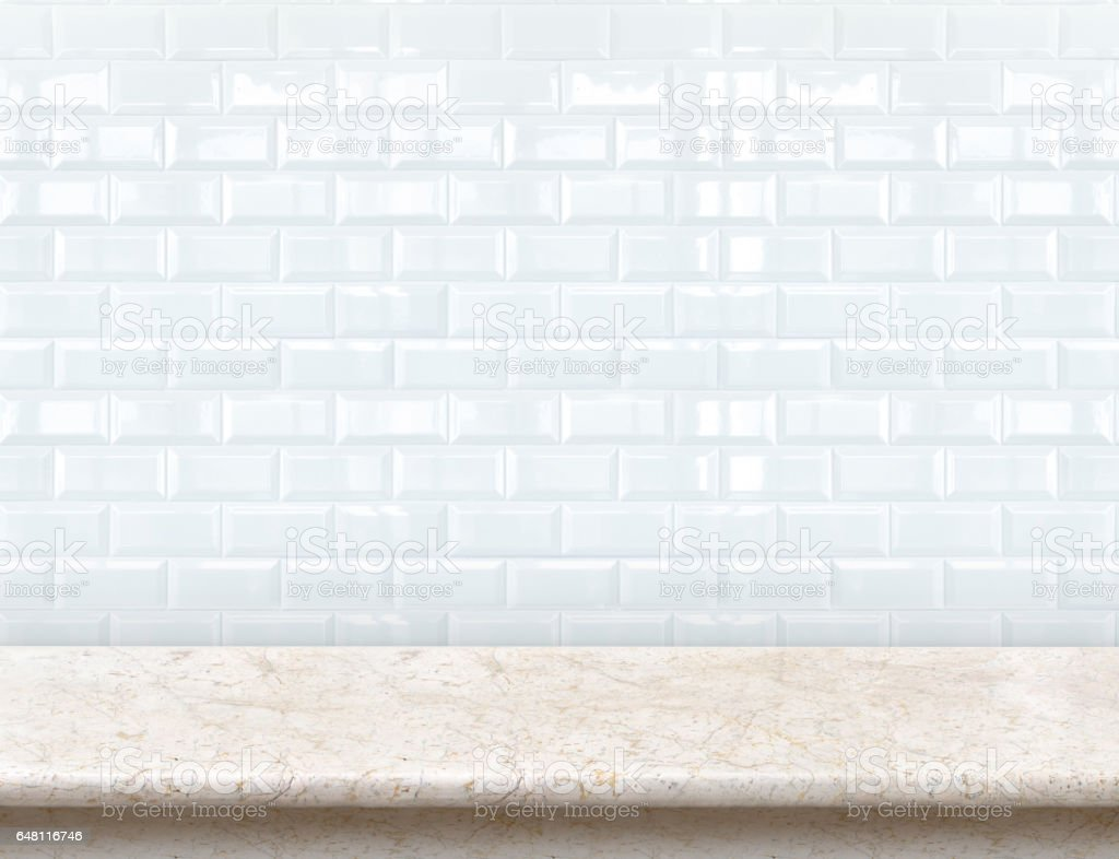 Empty marble table with ceramic tile wall stock photo