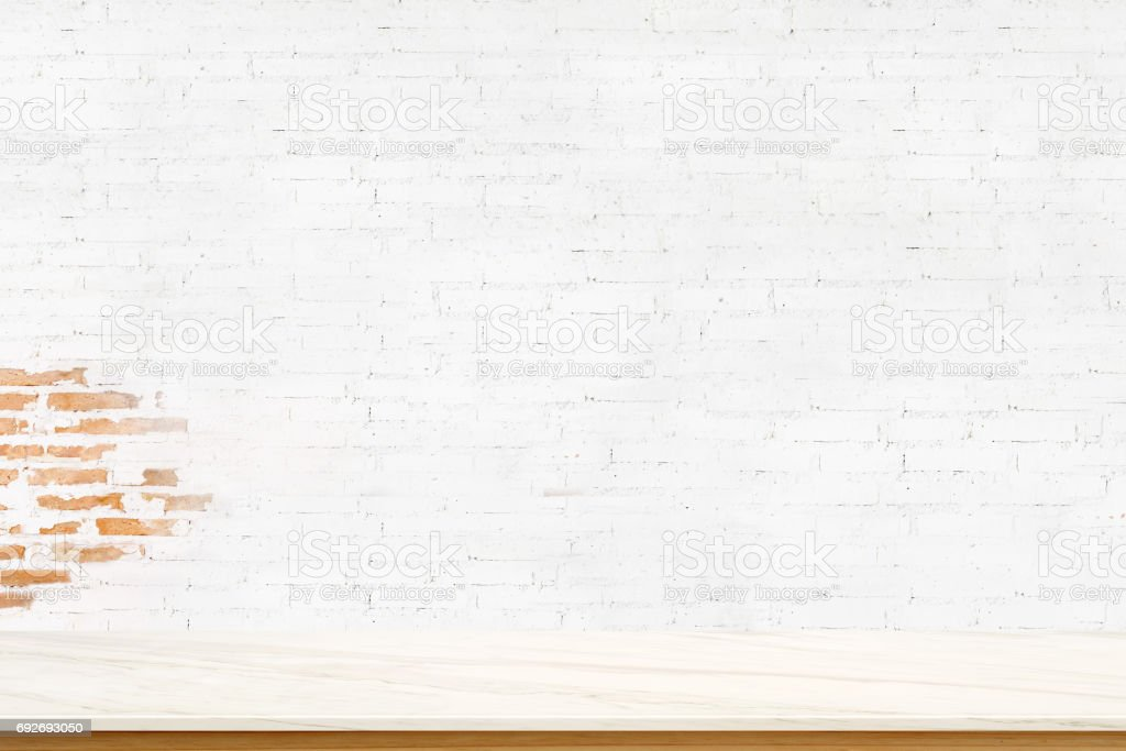 Empty marble top table and white brick wall. for Procuct display montage. stock photo