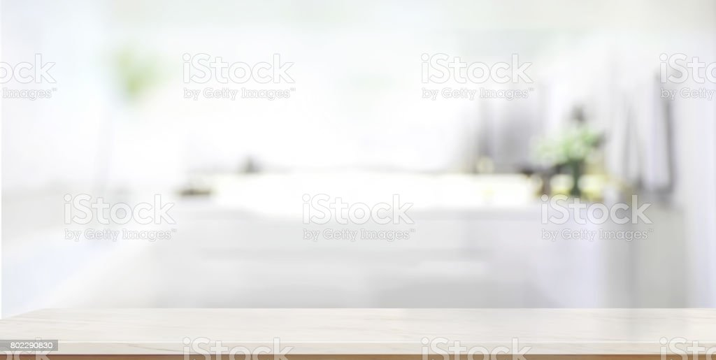 Empty marble top table with blurred bathroom interior Background. stock photo