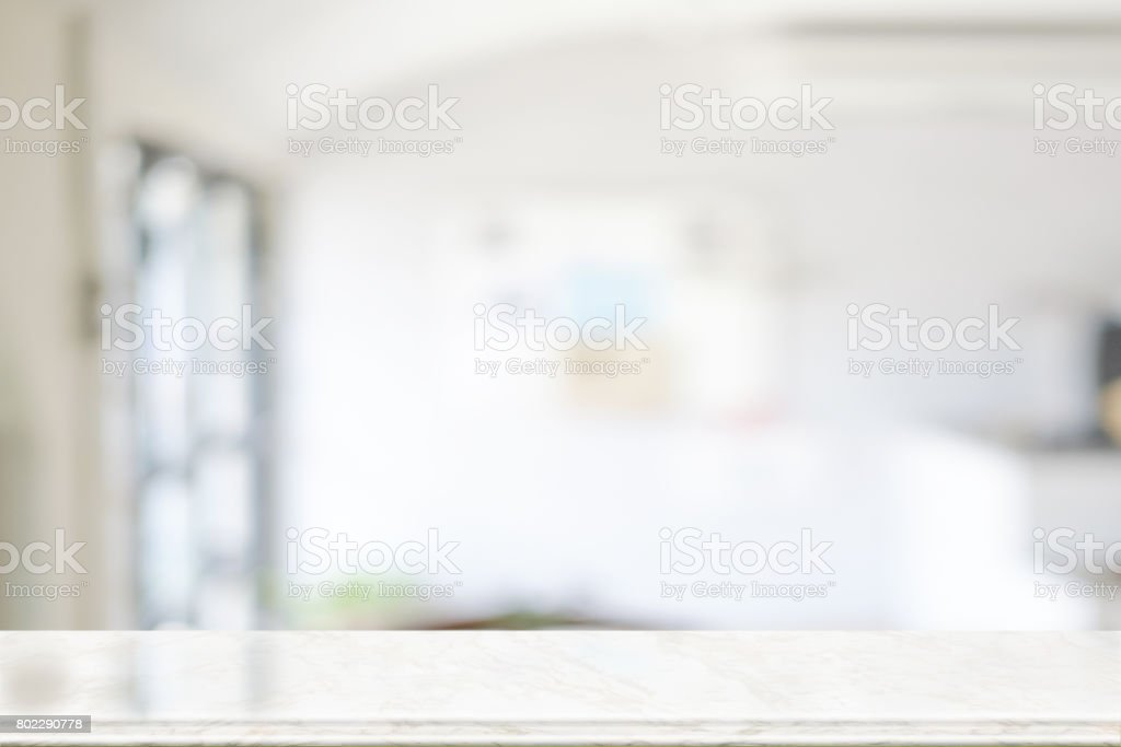 Empty marble top table with blurred coffee shop interior Background. f stock photo