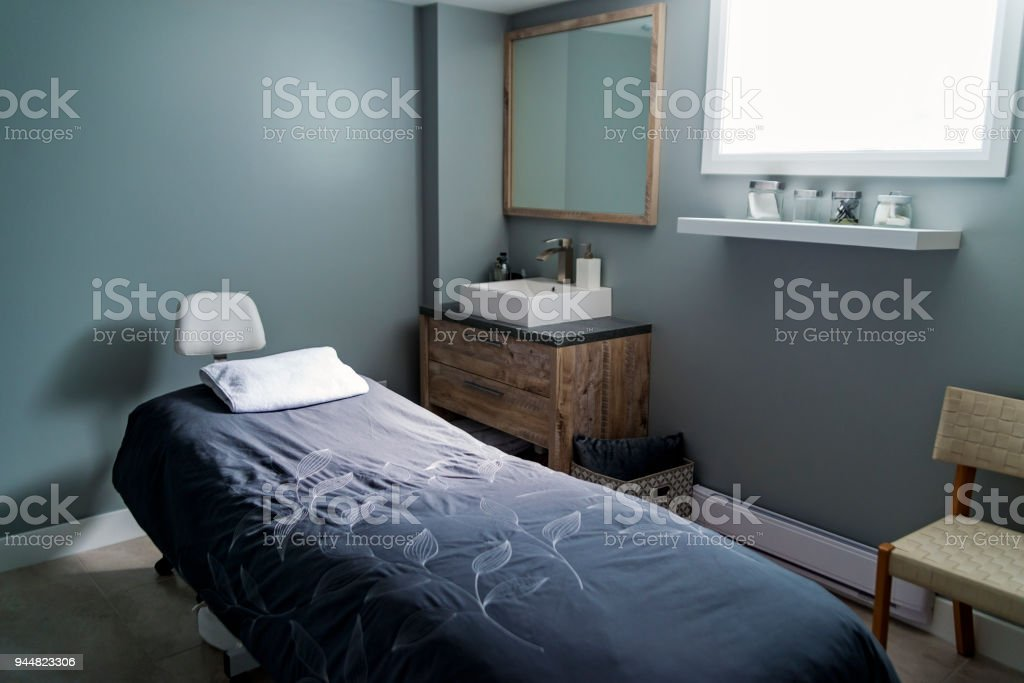 Empty massage room in a beauty spa. stock photo